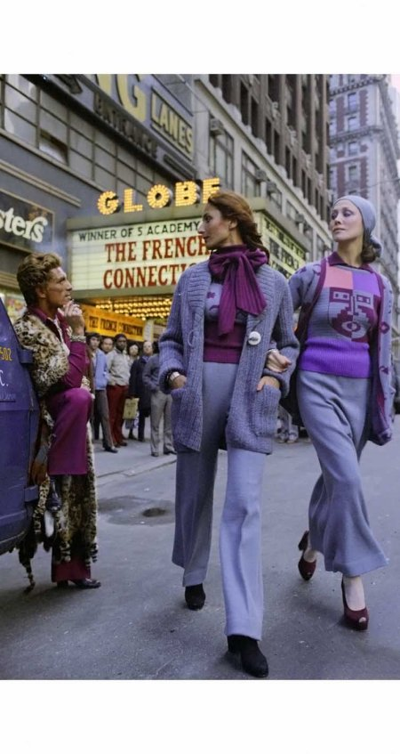 italian-designer-giorgio-di-santangelo-watches-models-wearing-knitwear-from-his-fall-1972-collection-pass-by-a-theater-playing-the-french-connectio-pierre-schermann