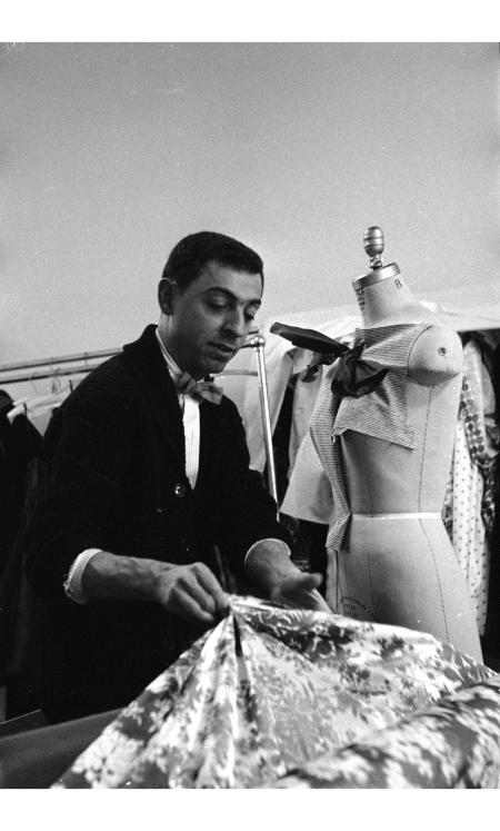 james-galanos-examines-a-bolt-of-fabric-1954-allan-grant