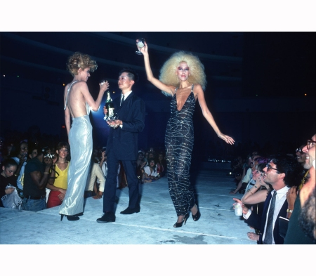 lucile-reader-benjamin-liu-and-jenna-torres-from-the-new-wave-agency-la-rocka-on-the-runway-at-bond-international-casino-in-times-square-in-1980-the-women-wear-fashions-designed-by-charles-james-a