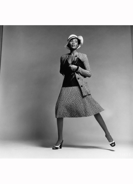 model-beverly-johnson-wearing-a-tweed-sweater-suit-with-long-button-front-cardigan-matching-flared-skirt-and-sheer-ribbed-pullover-by-scott-barrie-with-a-hat-by-don-marshall-and-envelo