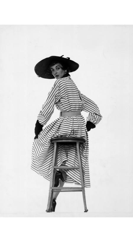 model-dorian-leigh-wearing-black-white-striped-dress-by-jacques-fath-joseph-halpert-w-black-cartwheel-hat-1950-gjon-mili