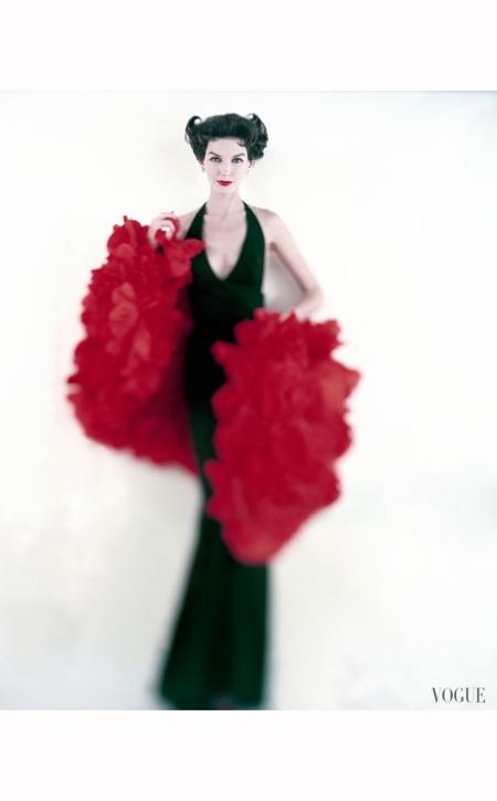 model-joanna-mccormick-in-long-black-scassi-dress-with-stole-of-silk-poppy-petals-vogue-1957-karen-radkai