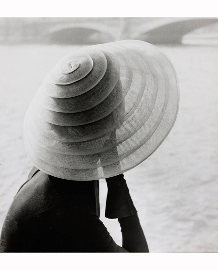 model-wearing-hat-by-jacques-fath-sitting-by-the-river-seineparis-1951