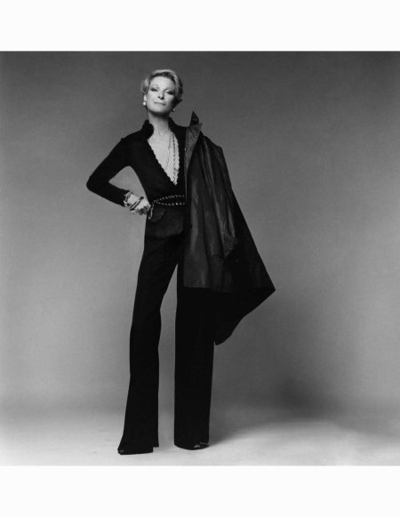 nan-kempnerwearing-an-adolfo-mohair-jacket-worn-as-open-necked-sweater-with-gabardine-pants-by-yves-saint-laurent-chanel-belt-and-halston-raincoat-over-her-shoulder-vogue-january-1974-frances