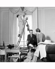 pierre-balmain-observing-modelling-an-evening-dress-designed-by-him-1951-nina-leen-b