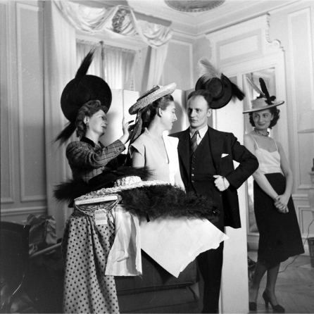 pierre-balmain-observing-modelling-an-evening-dress-designed-by-him-1951-nina-leen