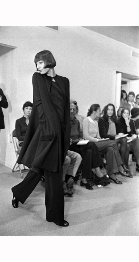 angelica-huston-models-a-tent-coat-blouse-and-pants-from-the-halston-1973-pierre-schermann-corbis