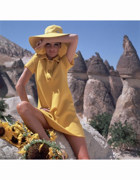 editha-dussler-in-goreme-turkey-wearing-bright-yellow-dress-with-yellow-and-white-striped-side-panels-by-leslie-fay-vogue-dec-1966-henry-clarke