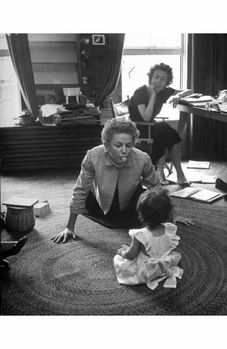 eileen-ford-conducting-her-job-of-running-the-ford-model-agency-while-model-jone-pedersen-entertains-fords-daughter-1948-nina-leen