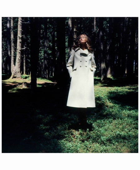 field-of-the-tyrol-veruschka-standing-in-the-igls-woods-wearing-a-beige-wool-officers-coat-with-silver-tyrol-buttons-by-ginala-igls-innsbruck-austria-vogue-oct-1967-franco-rubartelli