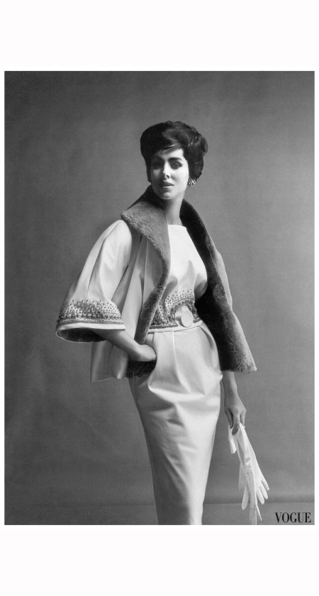 maggi-eckardt-is-wearing-oyster-white-satin-gown-embroidered-with-bronze-and-grey-beads-the-jacket-lined-and-collared-in-beaver-by-norman-hartnell-photo-by-vernier-vogue-uk-september