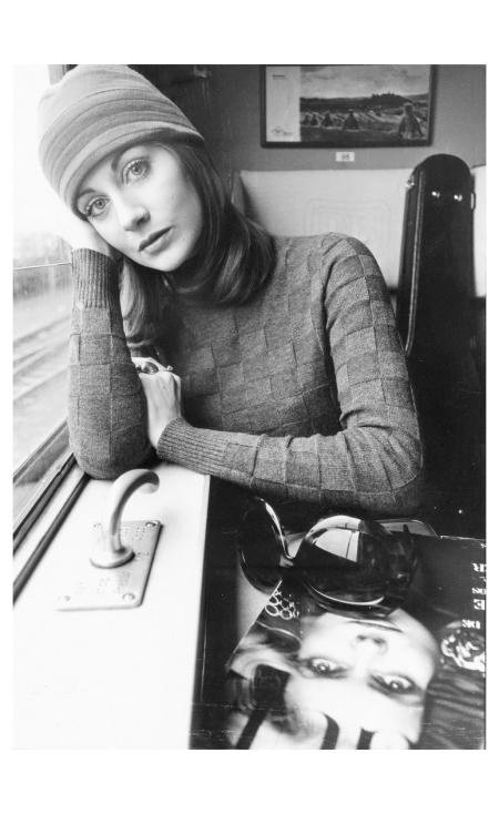 model-in-travel-wardrobe-falke-fashion-model-in-a-train-compartment-hamburg-1970-photo-fc-gundlach