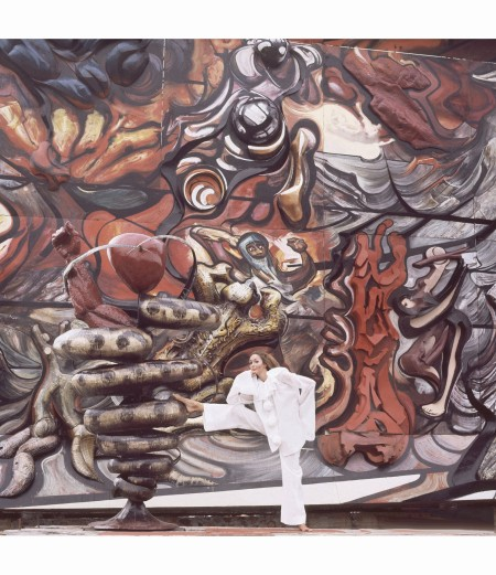 model-posed-before-david-alfaro-siqueiros-mural-the-march-of-humanity-in-cuernavaca-wearing-a-white-pierrot-jumpsuit-by-rikki-for-sport-trio-vogue-december-1968-henry-clarke