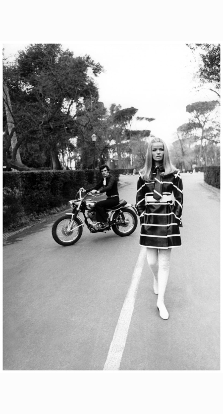 p-man-on-ducati350motorbike-on-the-fontana-dei-cavalli-marini-at-the-villa-borghese-wearing-black-shirt-and-trousers-with-snakeskin-belt-and-carlo-palazzi-scarf-and-veruschka-wearing