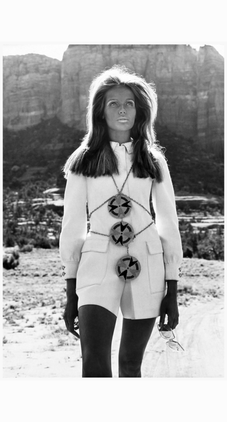 veruschka-wearing-fly-front-rayon-culotte-dress-with-double-buttoned-long-sleeves-deep-flap-pockets-designed-by-ginori-and-three-large-disks-with-native-american-motifs-by-van-rouge