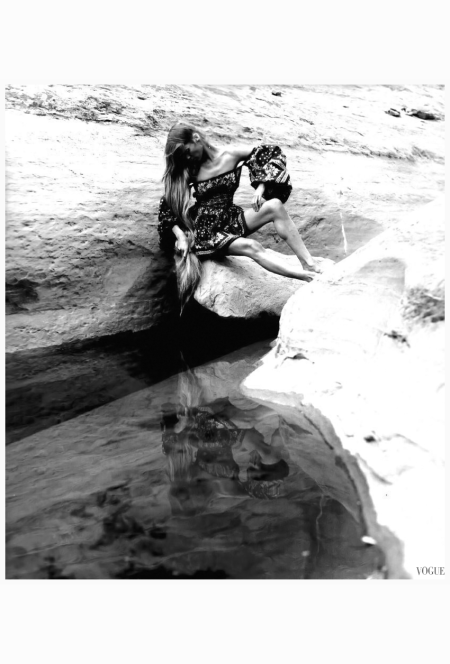 veruschka-wearing-off-the-shoulders-billow-sleeved-dress-made-of-bandannas-designed-by-james-douglas-goodson-sitting-on-a-rock-formation-and-gazing-at-herself-in-a-pool-of-water-arizo