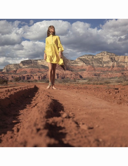 walking-down-a-red-dirt-road-in-the-arizona-desert-wearing-a-short-yellow-russian-throat-banded-shirt-dress-by-gayle-kirkpatrick-and-gold-foot-chain-wrapped-on-her-ankle-by-sant-angelo-vogue-1968