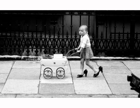 a-young-child-playng-at-being-an-adult-bayswater-london-david-hurn