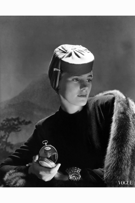 actress-frances-farmer-wearing-red-jersey-hat-with-jeweled-clip-designed-by-agnes-dress-fur-stole-and-large-metal-cuff-holding-small-mirror-inset-with-repeat-image-of-photograp-horst-p-horst-vogu