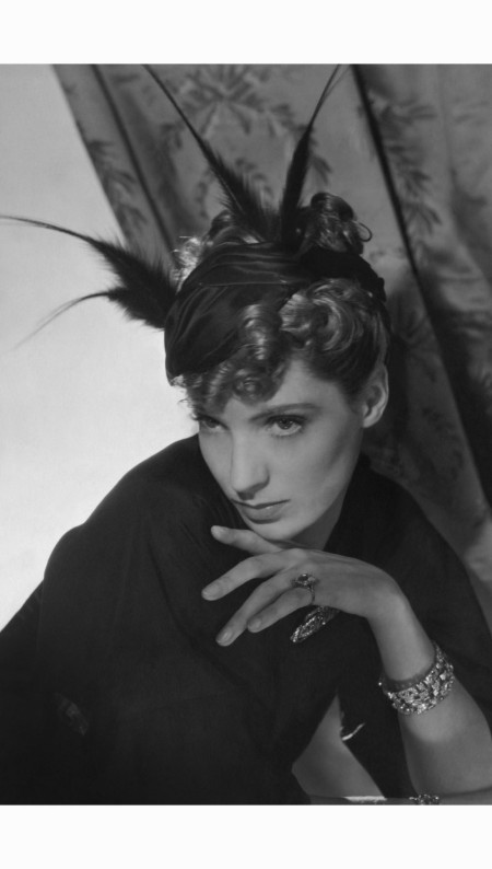 agneta-fischer-modeling-a-reboux-black-satin-hat-with-feather-plumes-her-hand-under-her-chin-hair-by-emile-horst-p-horst-vogue-july-1934