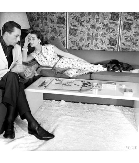 anne-gunning-parker-wearing-silk-shantung-pajamas-with-watermelon-slice-design-reclining-on-couch-with-dog-and-unidentified-man-seated-next-to-her-horst-p-horst-vogue-may-1954-1