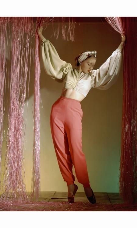 ballerina-irina-baronova-standing-under-curtains-wearing-harlequin-lounging-pyjamas-with-narrow-trousers-and-bare-midriff-blouse-horst-p-horst-vogue-july-1940