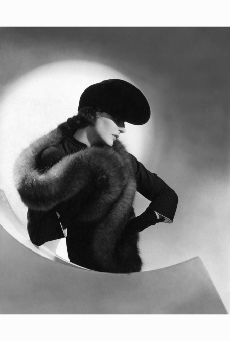betty-maclauchlen-in-a-fox-stole-black-dress-with-white-lining-and-tilted-black-velvet-pancake-hat-by-schiaparelli-standing-with-her-hand-on-her-hip-horst-p-horst-vogue-july-1937