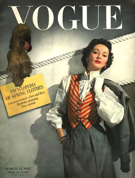 betty-mclauchlen-in-grey-suit-with-stripped-yellow-and-red-waistcoat-with-dog-behind-he-horst-p-horst-vogue-march-1942-cover