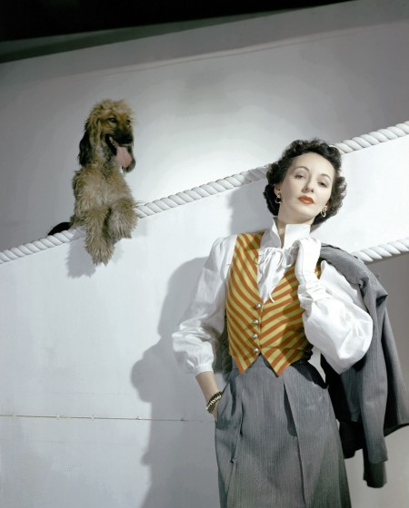 betty-mclauchlen-in-grey-suit-with-stripped-yellow-and-red-waistcoat-with-dog-behind-he-horst-p-horst-vogue-march-1942