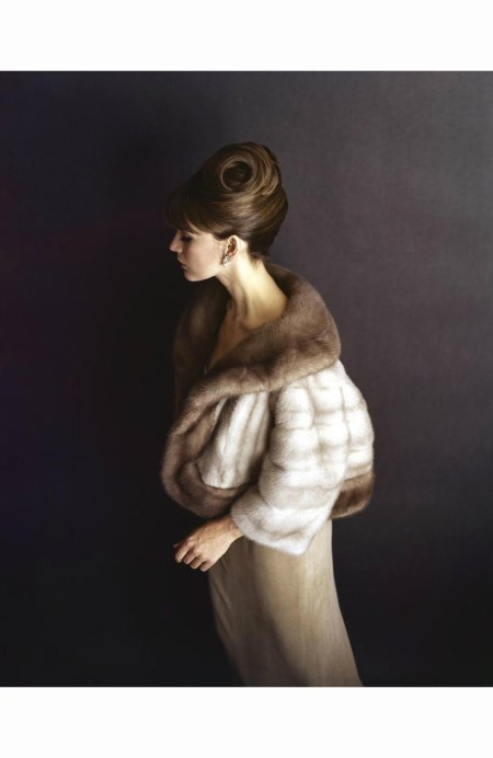brunette-model-with-cropped-fur-jacket-tan-evening-dress-and-pearl-earrings