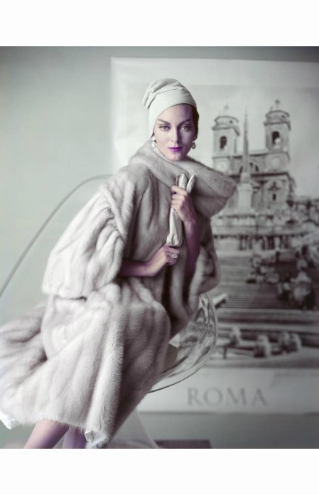 carmen-dellorefice-seated-on-a-lucite-chair-modeling-an-emba-aeolian-natural-grey-taupe-mutation-mink-designed-by-emilio-schuberth-of-rome-and-diamond-jewelry-by-harry-winston-with-a-hat-and-gloves