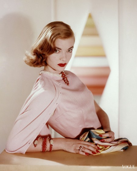 charlotte-payne-in-a-pink-sheath-dress-and-cashmere-sweater-with-coral-pearl-and-diamond-jewelry-by-cartier-1955-vogue-april-1955-horst-p-horst