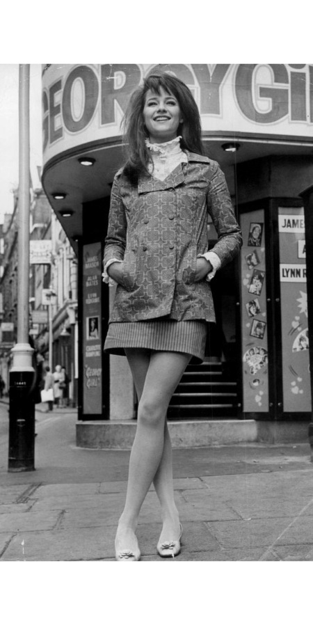 charlotte-rampling-wears-a-high-collared-edwardian-style-shirt-under-a-double-breasted-jacket-her-mini-skirt-is-in-contrasting-stripes-richard-chowen-b