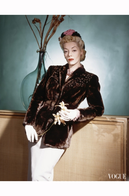 helen-bennett-standing-with-velvet-and-net-turban-topping-a-pompadour-and-wearing-an-alaskan-sealskin-in-matara-brown-with-sequins-horst-p-horst-vogue-august-1940