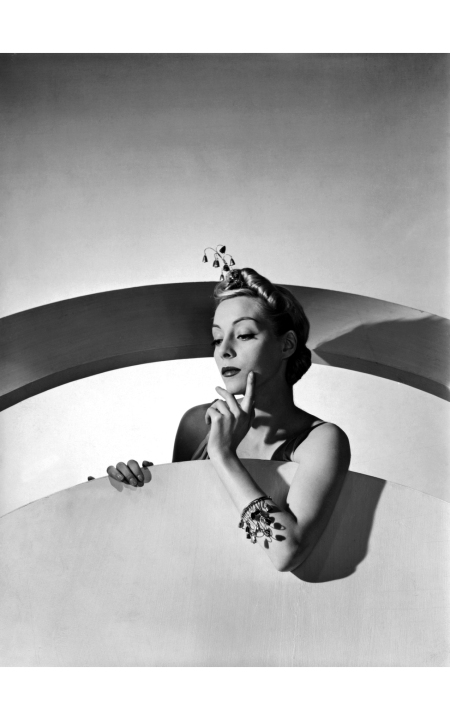 helen-bennett-wearing-hair-ornament-of-quivering-gold-bells-which-also-form-her-bracelet-both-by-mainbocher-horst-p-horst-vogue-march-1938