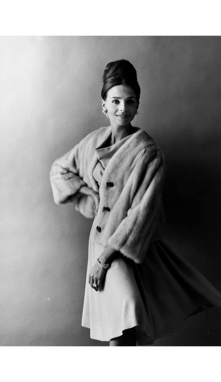 iris-bianchi-with-her-hair-up-modeling-a-fur-coat-in-a-dress-and-diamond-jewelry-1960s
