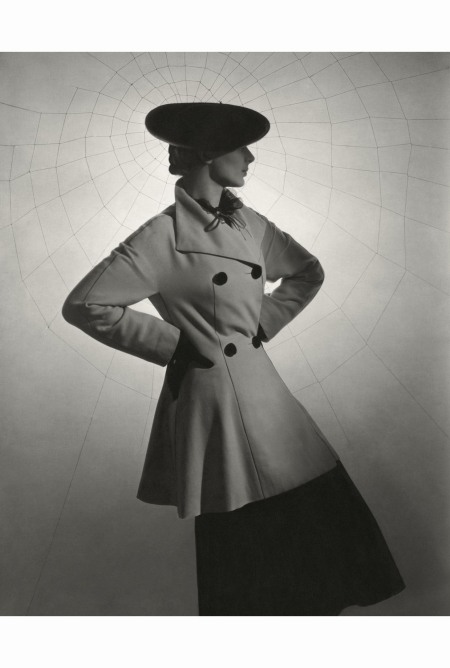model-agneta-fischer-wearing-duvetine-tunic-coat-black-skirt-lace-blouse-and-a-sailor-all-by-lanvin-standing-in-front-of-large-spider-web-horst-p-horst-vogue-march-1936