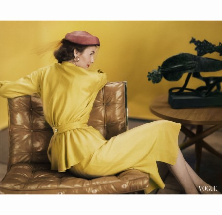 model-wearing-a-gold-two-part-dress-of-cohama-silk-shantung-sculpture-by-seymour-lipton-barcelona-chair-by-knoll-feb-1951