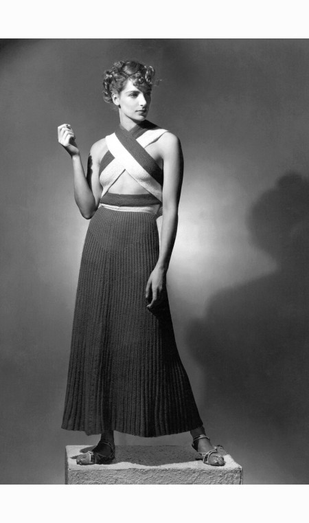 model-wearing-ribbed-knit-dress-with-bands-crossing-chest-by-olga-rosen-horst-p-horst-vogue-july-1934