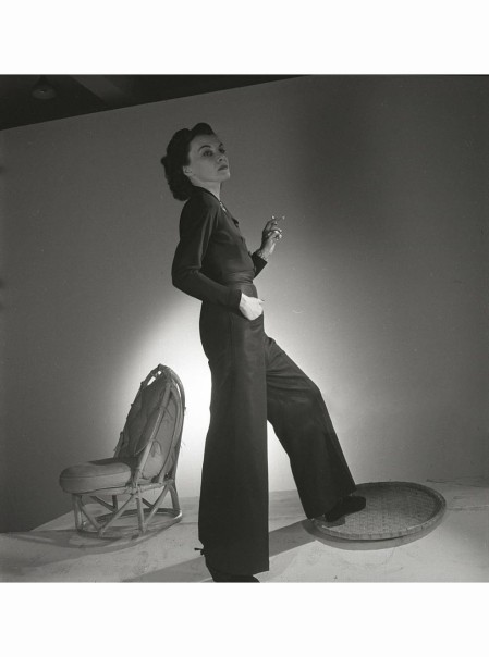 portrait-of-mrs-carroll-estrella-boissevain-she-is-standing-next-to-a-small-chair-wearing-a-wide-legged-jumpsuit-and-espadrilles-horst-p-horst