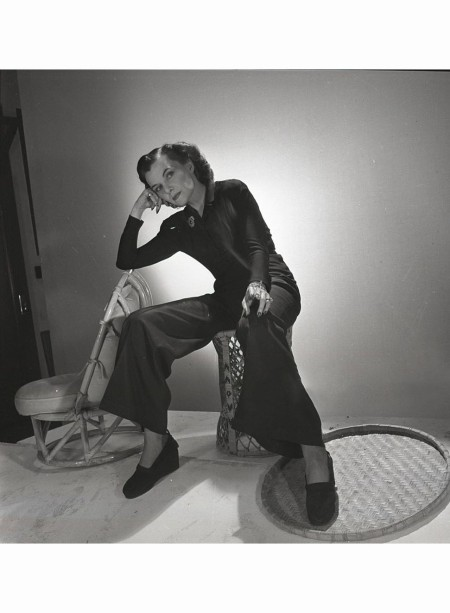 portrait-of-mrs-carroll-estrella-boissevain-she-is-standing-next-to-a-small-chair-wearing-a-wide-legged-jumpsuit-and-espadrilles-vogue-1942-horst-p-horst-b