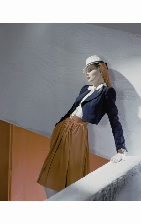 standing-model-wearing-white-hat-navy-jacket-and-red-skirt-horst-p-horst-vogue-march-1942