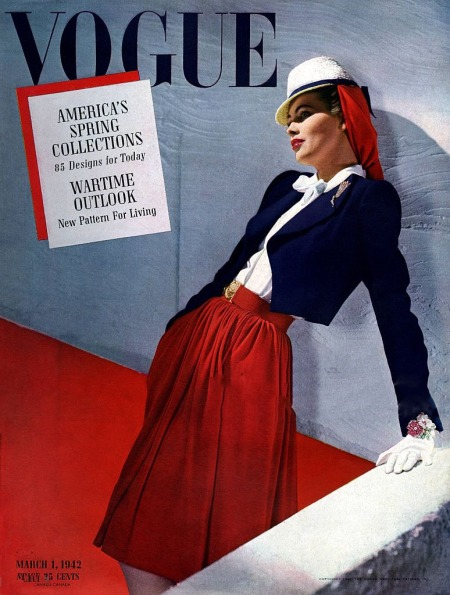 standing-model-wearing-white-hat-navy-jacket-and-red-skirt-traina-norell-rene-bouet-willaumez-john-frederics-vogue-march-1942-horst-p-horst