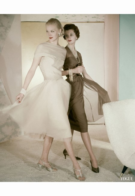 sunny-harnett-left-in-beige-chiffon-dress-cut-softly-over-the-shoulder-with-long-bodice-and-skirt-cut-on-the-bias-other-wearing-brown-chiffon-dress-twice-banded-around-the-bodice-with-brown-satin