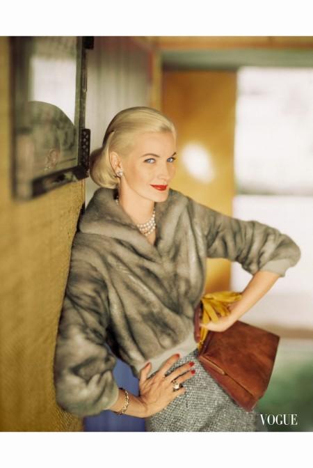 sunny-wearing-short-mink-jacket-with-tweed-skirt-bracelet-and-ring-by-verdura-leather-handbag-by-nettie-rosenstei-oct-1957