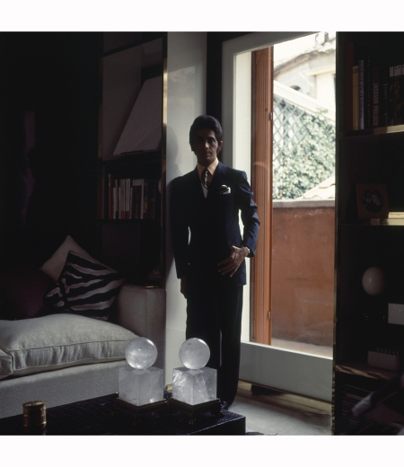 valentino-in-partial-shadow-leaning-against-a-exterior-doorway-wearing-a-suit-in-his-rome-duplex-apartmen-horst-p-horst-vogue-april-1970-valentino-at-home