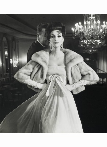 wilhelmina-with-her-hair-up-and-a-male-model-modeling-an-emba-%22azurene%22-natural-blue-grey-mink-jacket-in-an-evening-dress-with-diamond-earrings-gloves-at-the-pierre-hotel-new-york-for-harpers