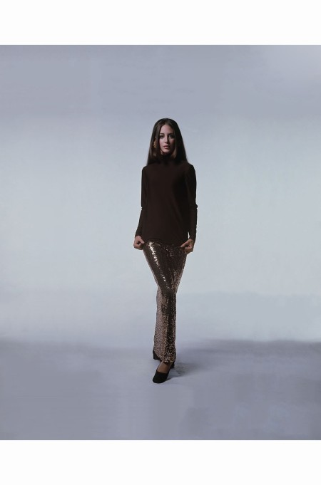 windsor-eliot-wearing-gooseneck-pullover-in-chocolate-brown-silk-jersey-and-a-matching-narrow-skirt-covered-in-golden-paillettes-dseigned-by-norell-hair-by-suga-of-kenneth-vogue-1968-bert-ster