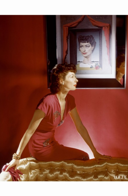 writer-ilka-chase-seated-beneath-her-portrait-by-richard-kitchin-wearing-a-long-red-gold-embroidered-dinner-dress-from-bergdorf-goodman-horst-p-horst-vogue-september-1943