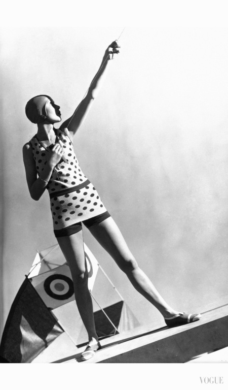 model-wears-a-polkadot-wool-jersey-bathing-suit-over-navy-shorts-with-a-swim-cap-and-striped-beach-shoes-all-designed-by-jeanne-lanvin-vogue-july-1-1928-george-hoyningen-huene